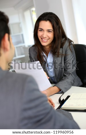 Businesswoman giving job interview