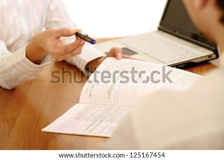 businesswoman giving you the pen and the contract to sign , isolated on white background