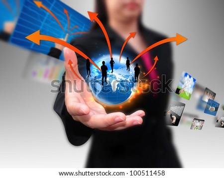 businesswoman hand holding business world - stock photo