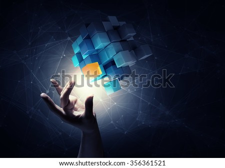 businesswoman hand touch cube...