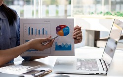 Businesswoman hands hold documents with financial statistic stock photo,discussion and analysis data the charts and graphs. Finance concept