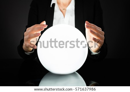 Businesswoman Hands On Crystal Ball On Black Background. Fortune Teller Predicting Future #571637986