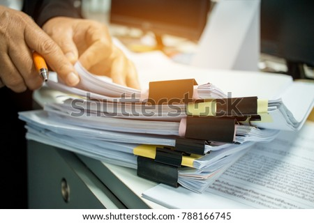 Businesswoman hands working on Stacks of documents files for finance in office. Business report papers or Piles of unfinished document achieves with black clip paper. Concept of Business Annual Report #788166745