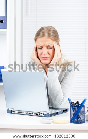 Businesswoman having headache,Headache at work