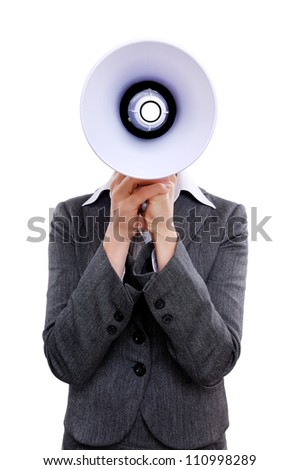 Businesswoman hiding face behind  the  megaphone against a white background - stock photo