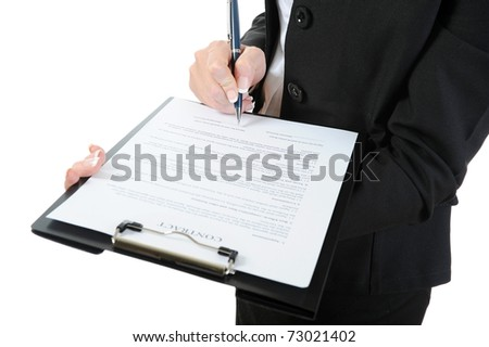 Businesswoman holding a clipboard signs contract. Isolated on white background