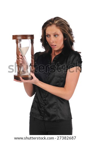Businesswoman holding a sand timer isolated against a white background