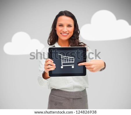 Businesswoman holding a tablet pc with shopping symbol and smiling