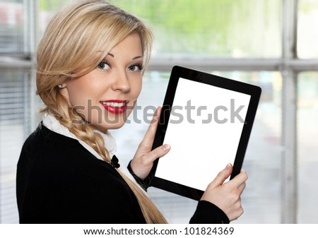 businesswoman holding a tablet touch pad computer gadget.