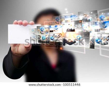 Businesswoman holding card .Technology concept
