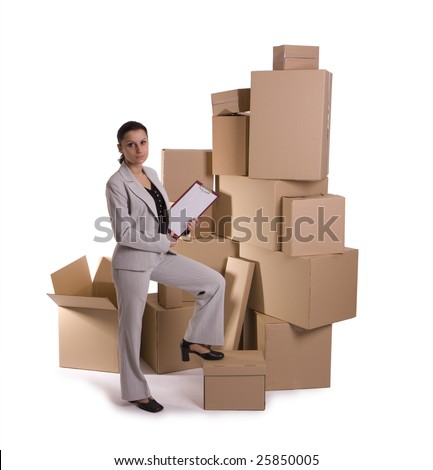 businesswoman holding clipboard, standing one leg on the cardboard box, carton  box in background