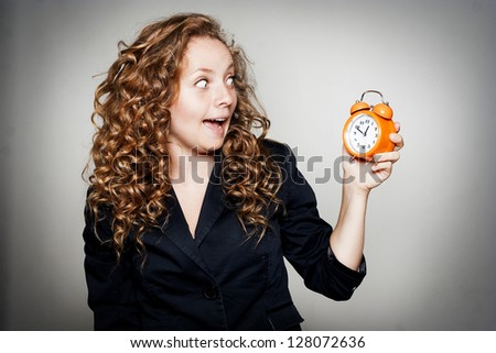 Businesswoman holding clock