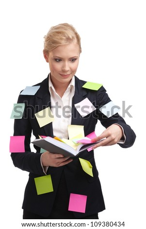 Businesswoman holding diary with a sticky notes on her suite