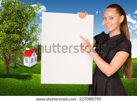 Businesswoman holding empty paper. House and nature landscape as backdrop