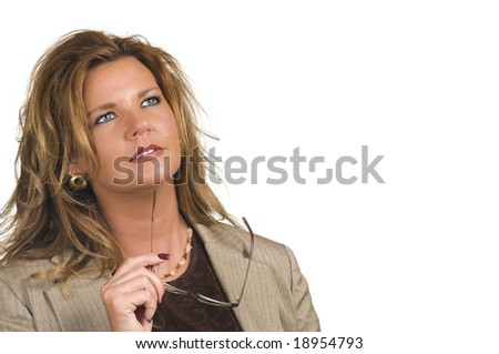 Businesswoman holding eyeglasses while looking away from the camera (thinking)