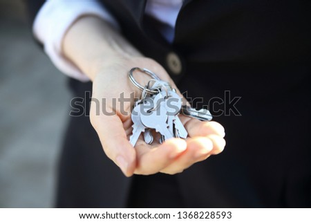Businesswoman holding keys