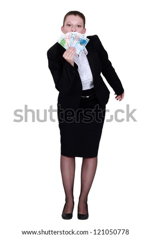 Businesswoman holding lots of bank notes
