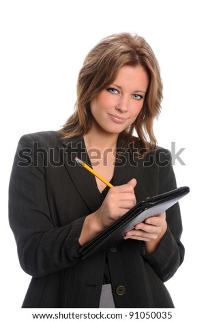 Businesswoman holding pencil and pad isolated over white background