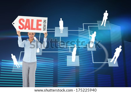 Businesswoman holding sign above her head against glowing blue bar chart on black background