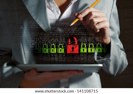 Businesswoman holding tablet pc entering password. Security concept