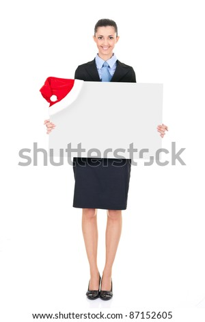 businesswoman holding  white blank billboard with santa hat, isolated on white background