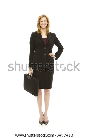 Businesswoman in a suit holds a briefcase