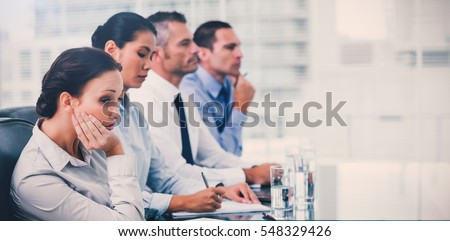 Businesswoman in bright office getting bored while attending presentation