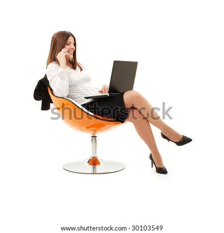 businesswoman in chair with laptop and phone over white