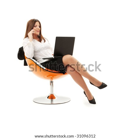 businesswoman in chair with laptop and phone over white - stock photo