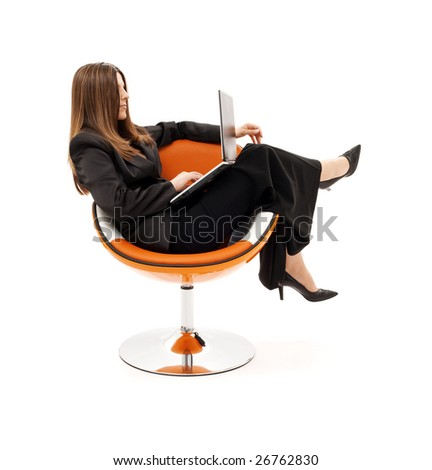 businesswoman in chair with laptop computer over white