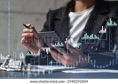 Businesswoman in formal wear is signing the contract to invest money in stock market. Internet trading and wealth management. Checking the details of transaction at smart phone. Forex ストックフォト ©