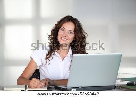 Businesswoman in front of computer in the office