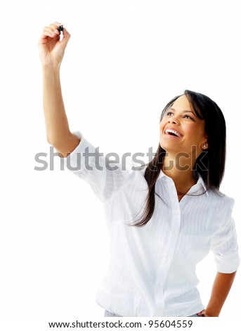 Businesswoman in long sleeved shirt holds up a felt tip pen to write in mid air, isolated on white