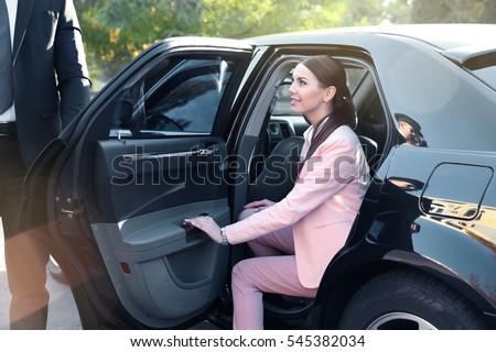 Businesswoman in luxury car