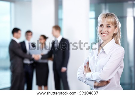 Businesswoman in office on the background of serving staff
