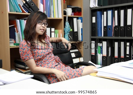Businesswoman in office with folder background