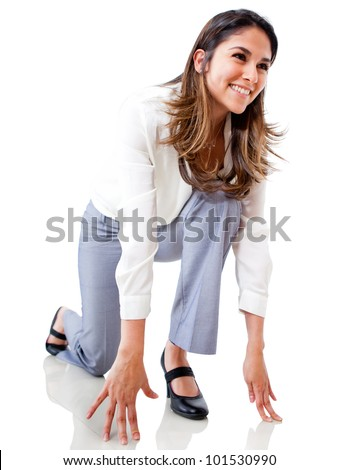 Businesswoman in position to run - isolated over a white background
