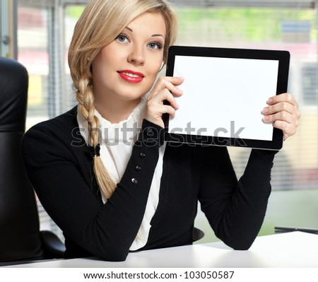 businesswoman in the office sitting at a table with tablet touch pad computer gadget. - stock photo