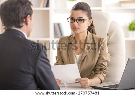 Businesswoman interviewing male candidate for job in office. #270757481