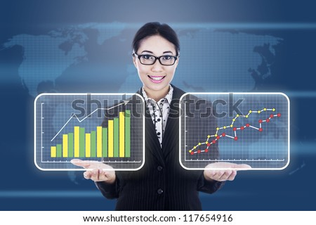 Businesswoman is presenting 2 different diagrams showing improvement or profit of a company