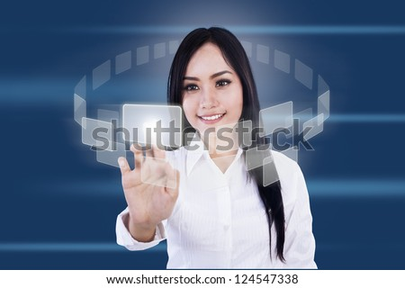 Businesswoman is pressing virtual icons on blue background