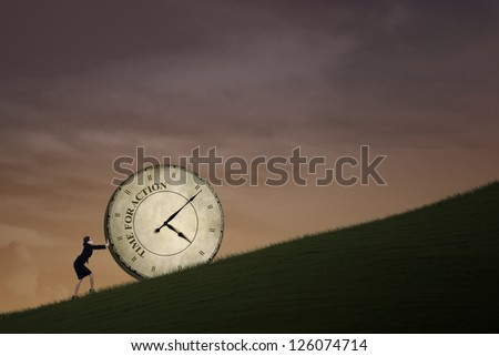 Businesswoman is pushing a big time clock on top of a hill. The clock is written Time
