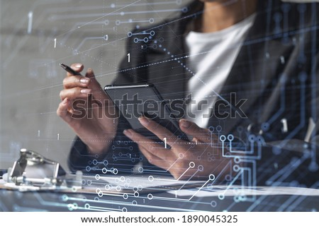 Businesswoman is signing the contract to create fin-tech start up for the conference and gain investments for innovative service. Checking the details at smartphone. Hologram tech graphs.