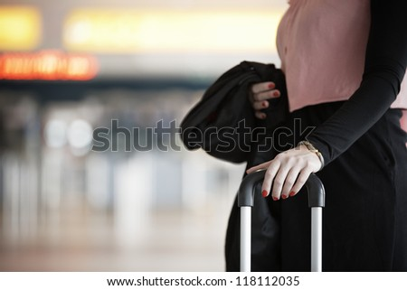 Businesswoman is waiting at the airport - selective focus
