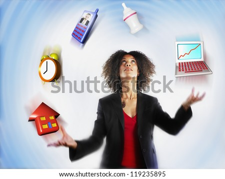 Businesswoman juggling responsibilities over colored background Stock photo ©