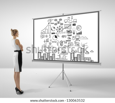 businesswoman looking at flip chart with business concept