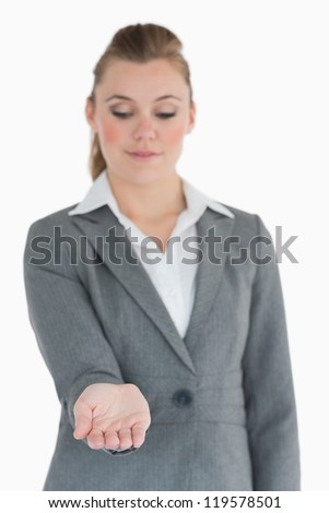 Businesswoman looking at her hand while smiling
