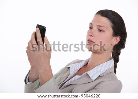 Businesswoman looking at her mobile phone