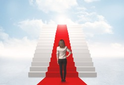 Businesswoman looking at stairs to heaven