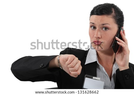 Businesswoman looking at the time